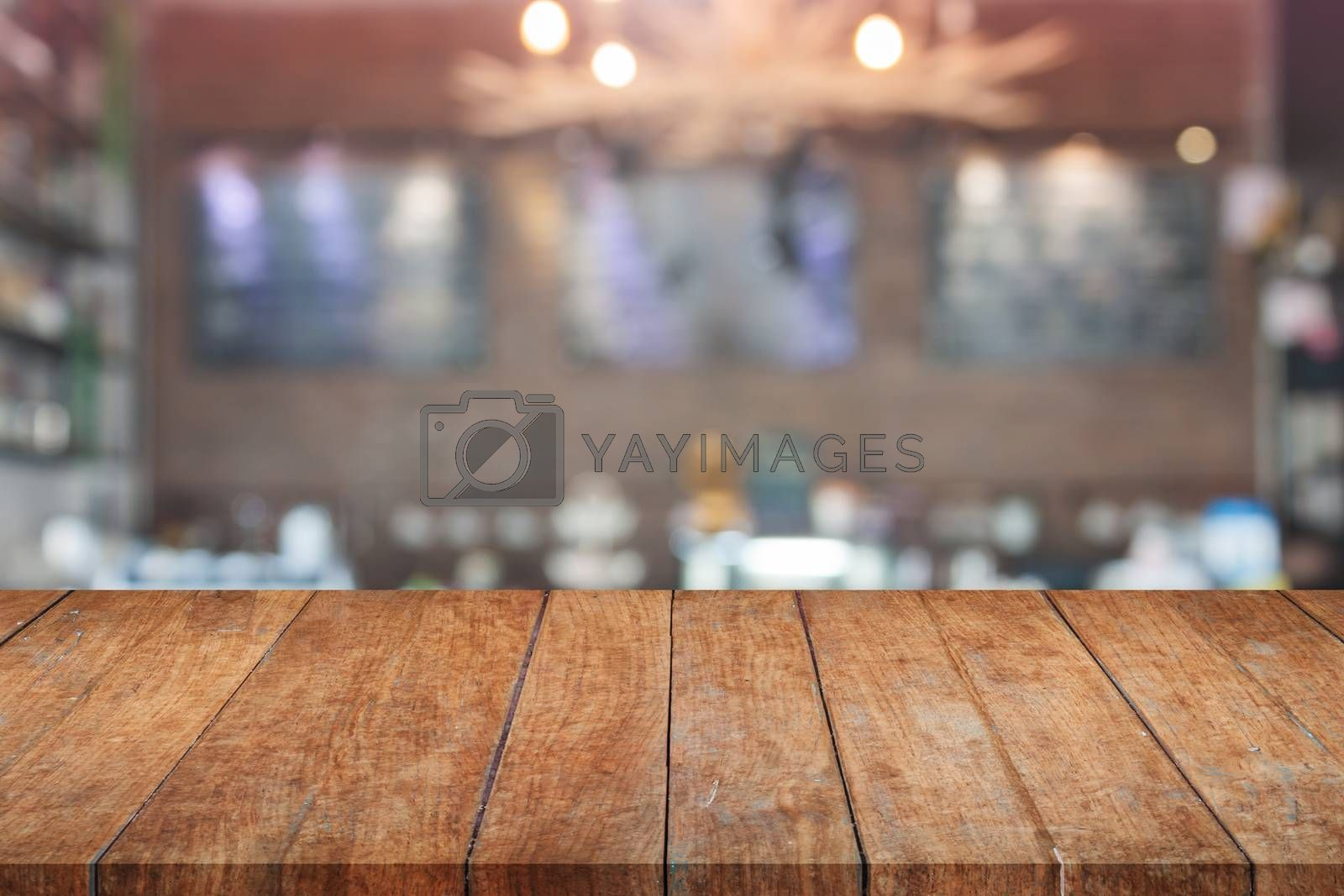 Brown wooden table top with blurred cafe. product display template