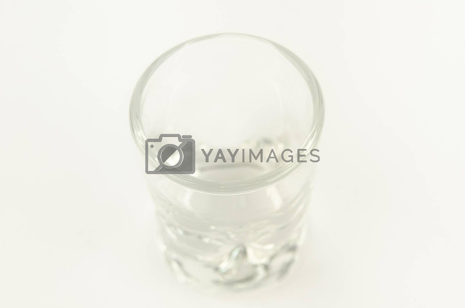 Clean and clear standing empty glass. On a white background.