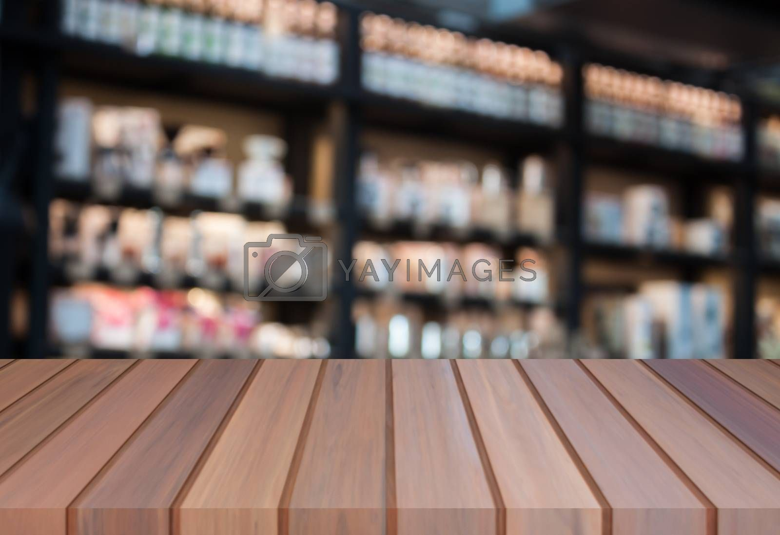 Perspective luxury brown wooden with blurred coffee shop background. product display template