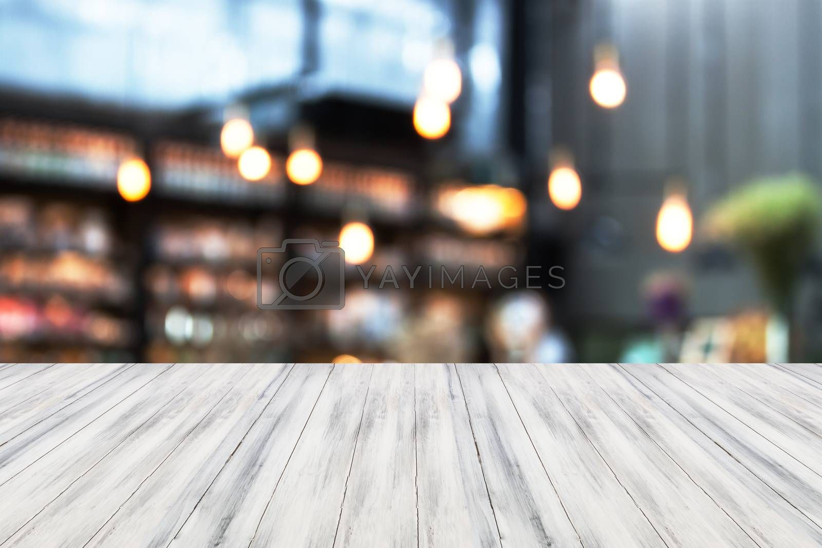 White luxury top wooden with blurred cafe background. product display template