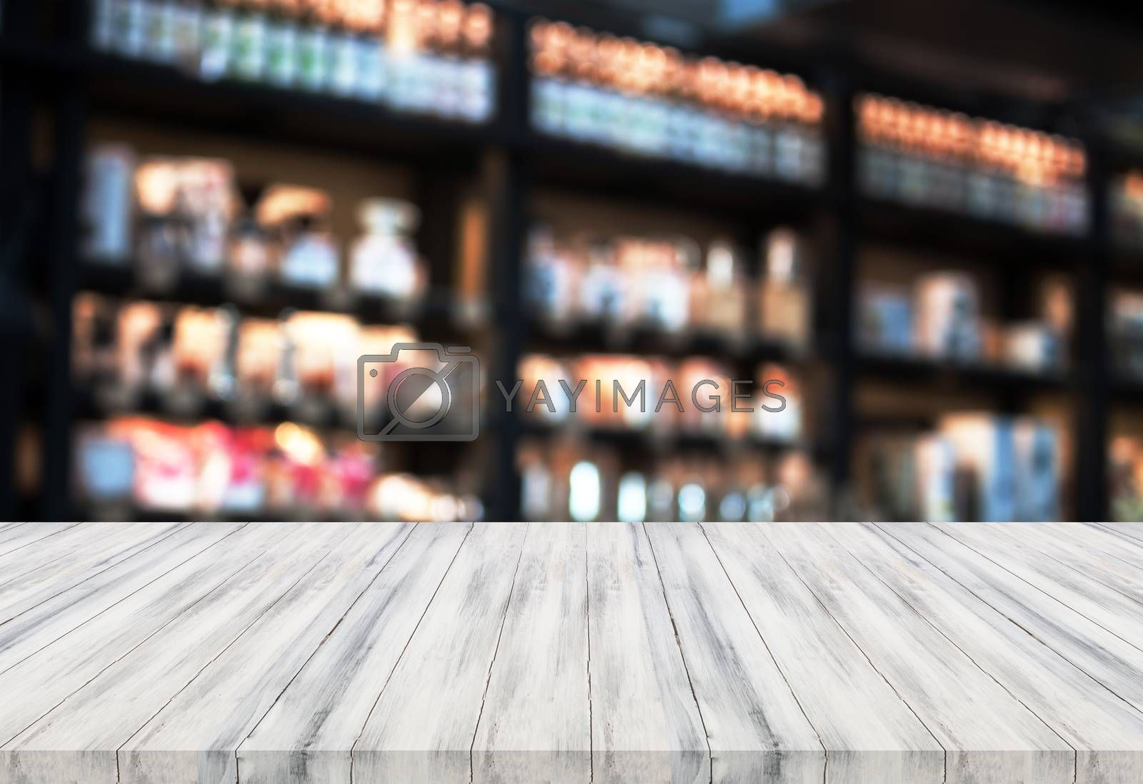 Luxury white wooden table top with blurred coffee shop background. product display template
