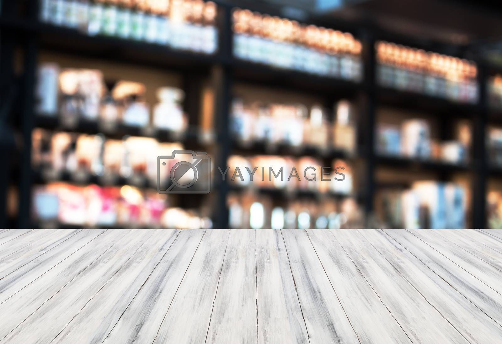 Luxury white top wooden with blurred coffee shop background. product display template