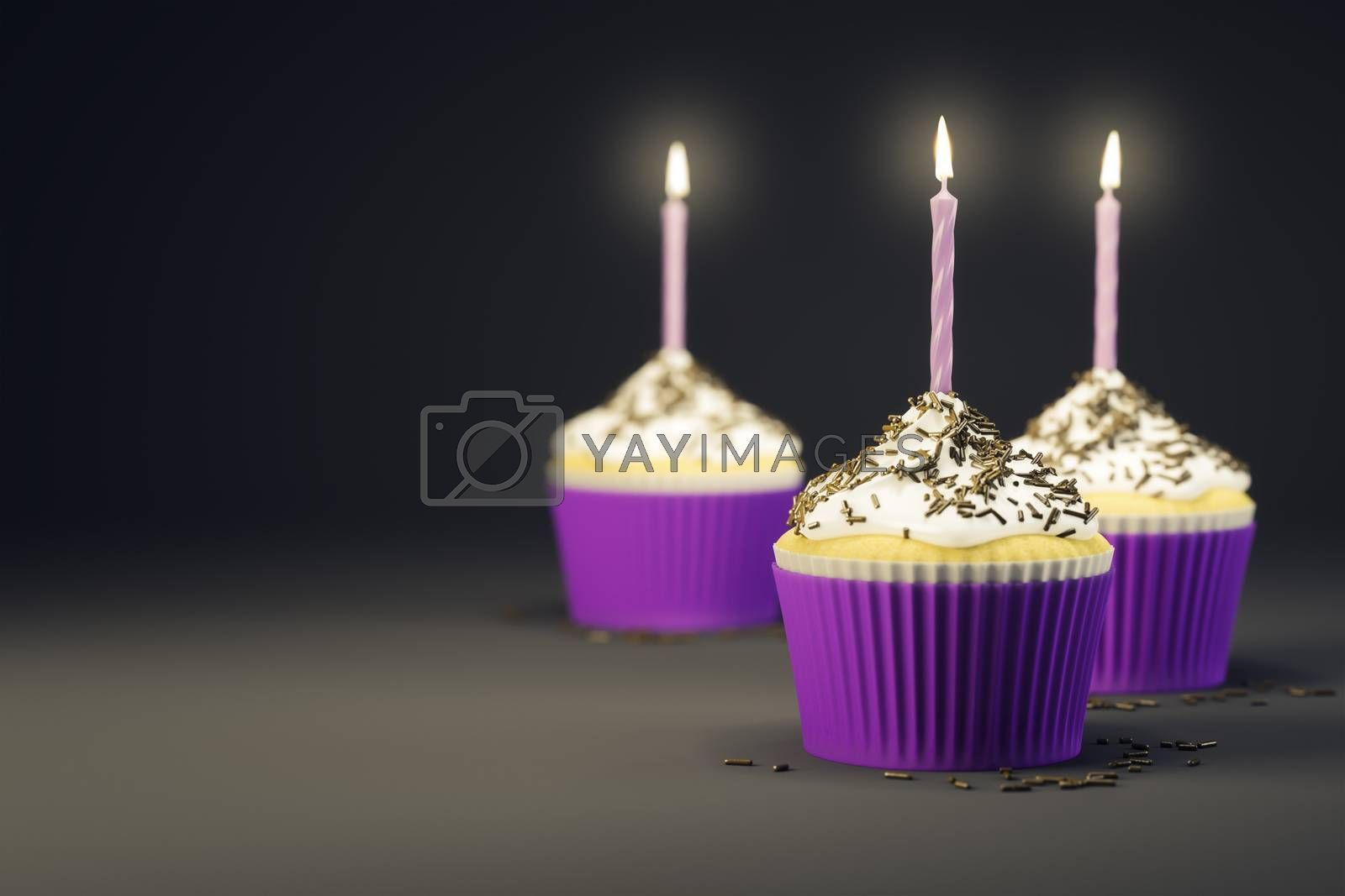 delicious cupcakes with a burning candles by magann