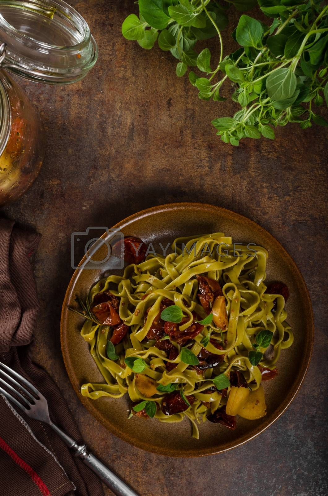 pasta with sun dried tomatoes and roasted garlic olive oil, fresh hebs in