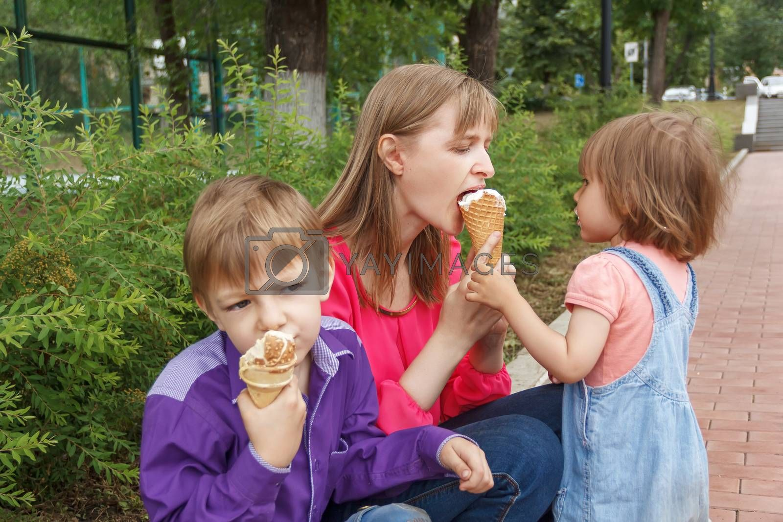 Nice family are eating icecream in summer