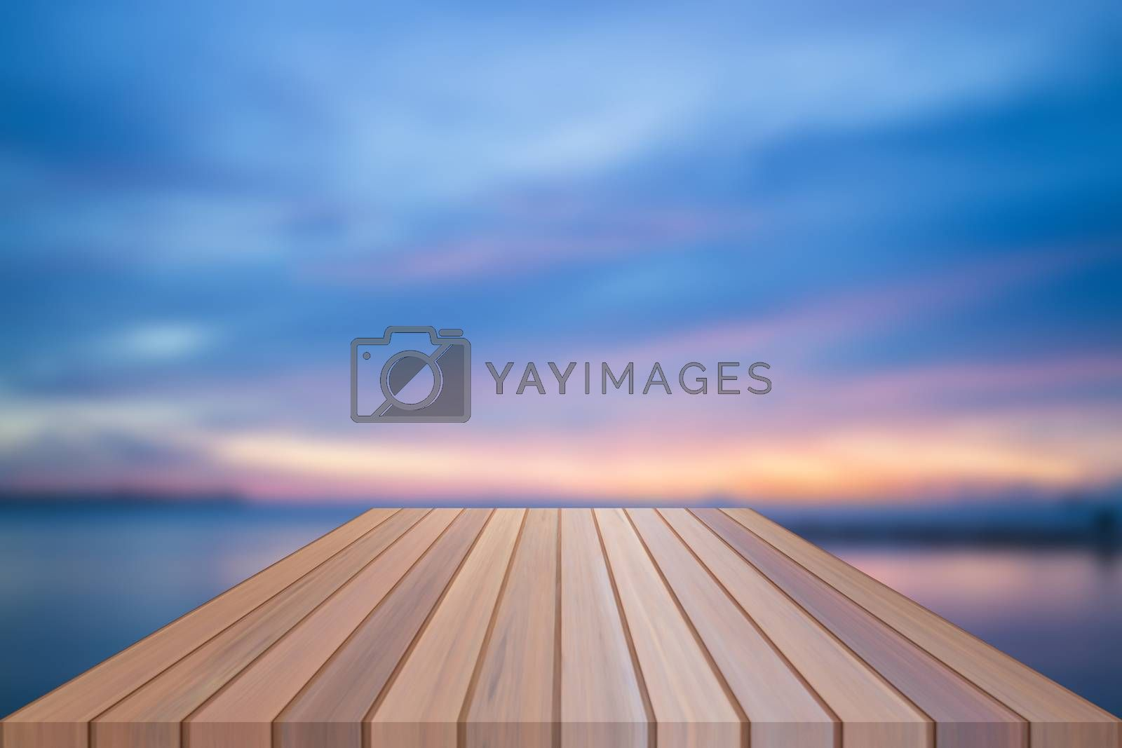 Empty table top of wooden table with sunset background. For product display