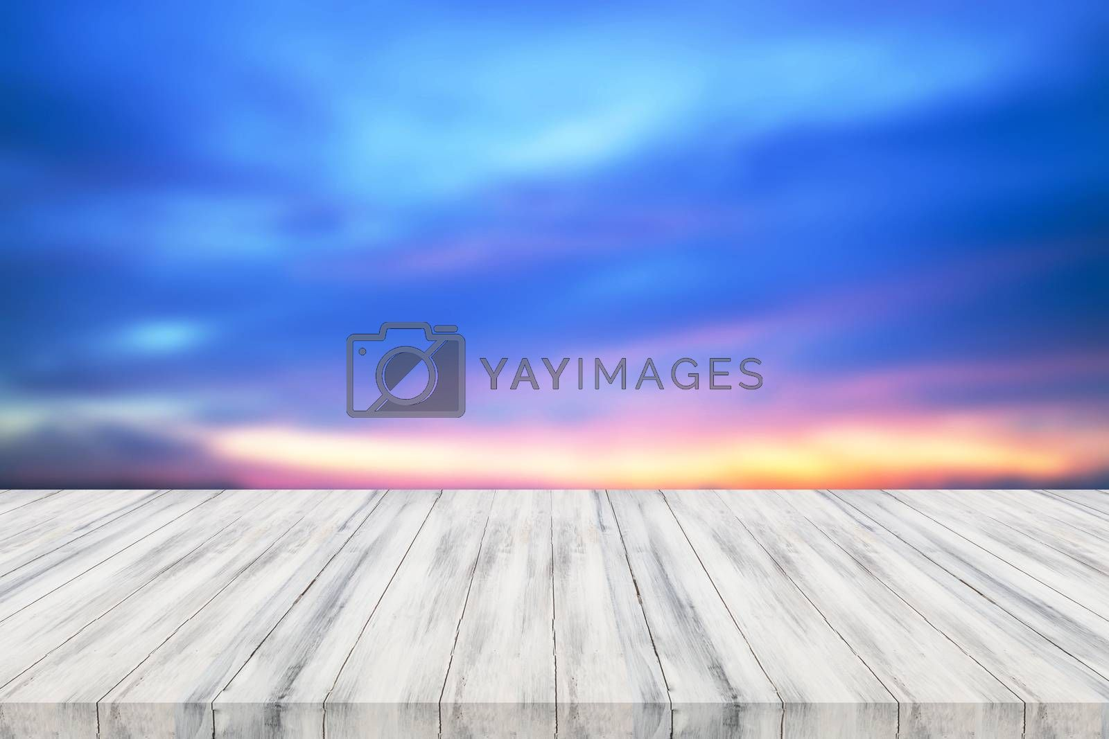 Empty white wooden table top with sunset background. For product display