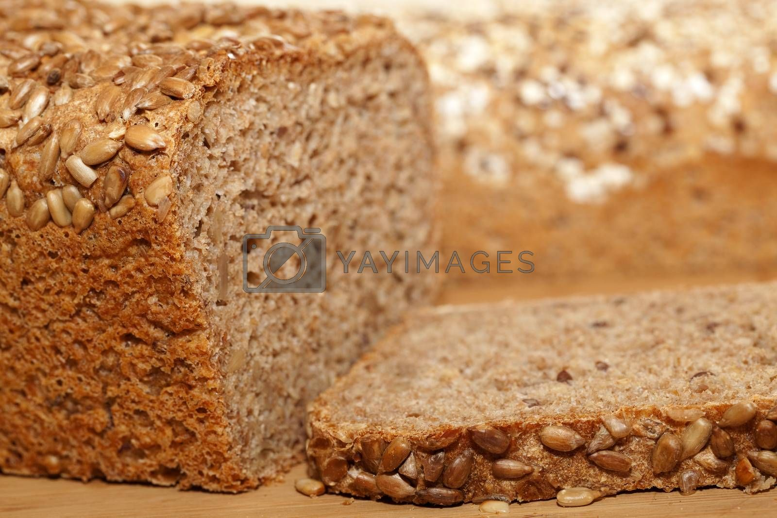 whole bread and slice of bread as background