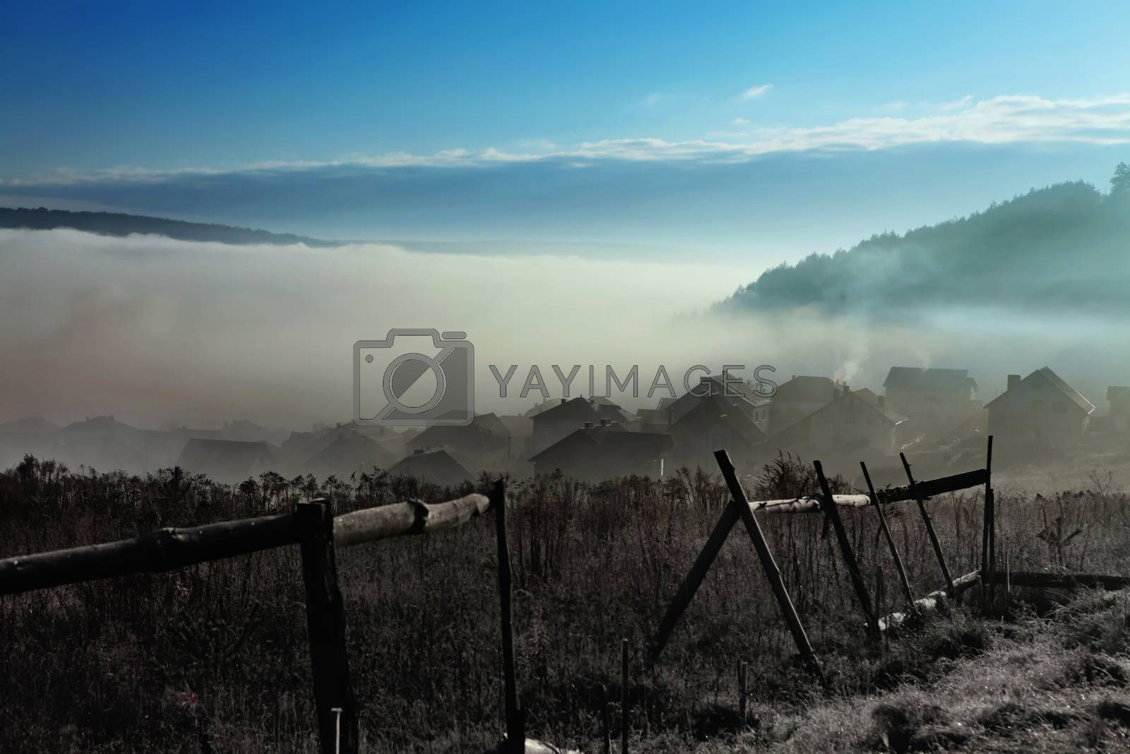 sky with fog over countryside at autumn