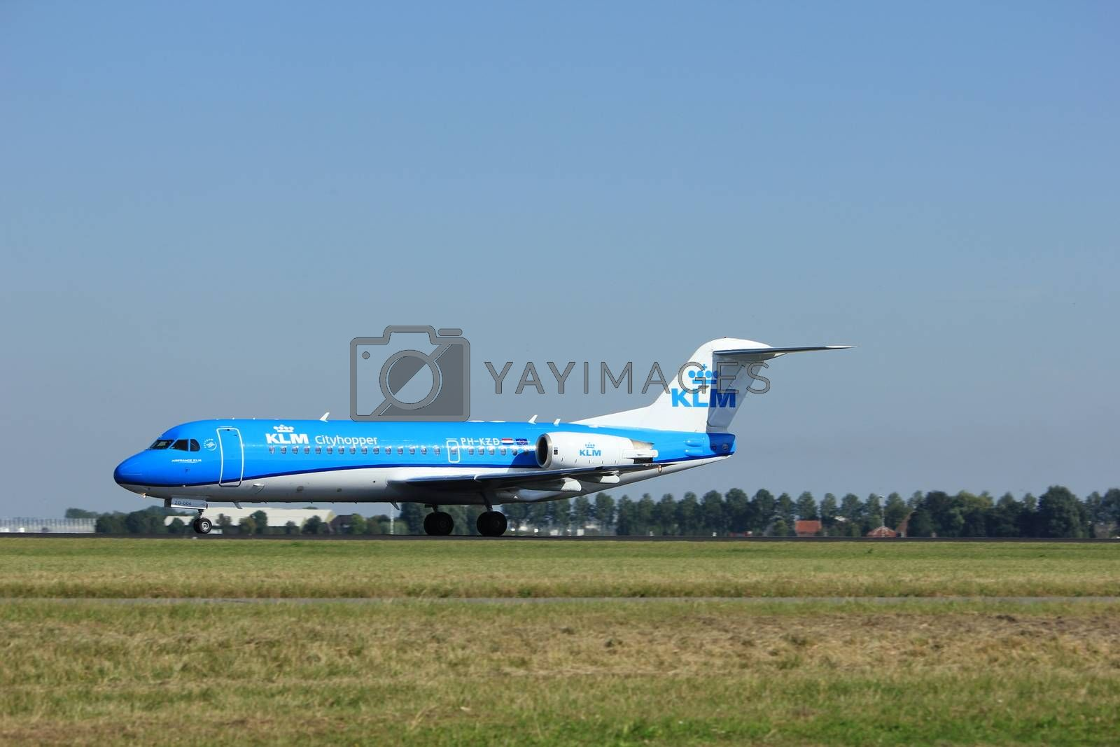 Amsterdam, the Netherlands  - August, 18th 2016: PH-KZD KLM Cityhopper Fokker F70, taking off from Polderbaan Runway Amsterdam Airport Schiphol