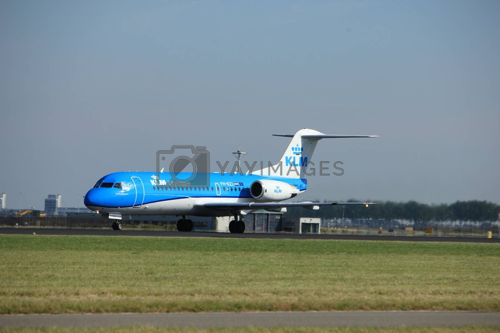 Amsterdam, the Netherlands  - August, 18th 2016: PH-KZL  KLM Cityhopper Fokker F70, taking off from Polderbaan Runway Amsterdam Airport Schiphol
