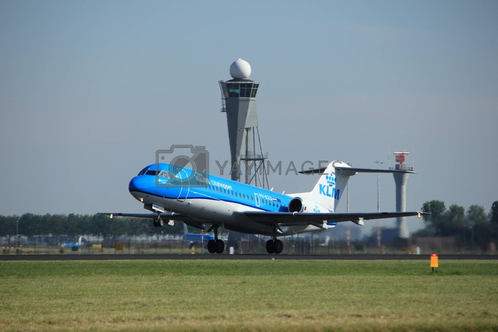 Amsterdam, the Netherlands  - August, 18th 2016: PH-KZU  KLM Cityhopper Fokker F70, taking off from Polderbaan Runway Amsterdam Airport Schiphol