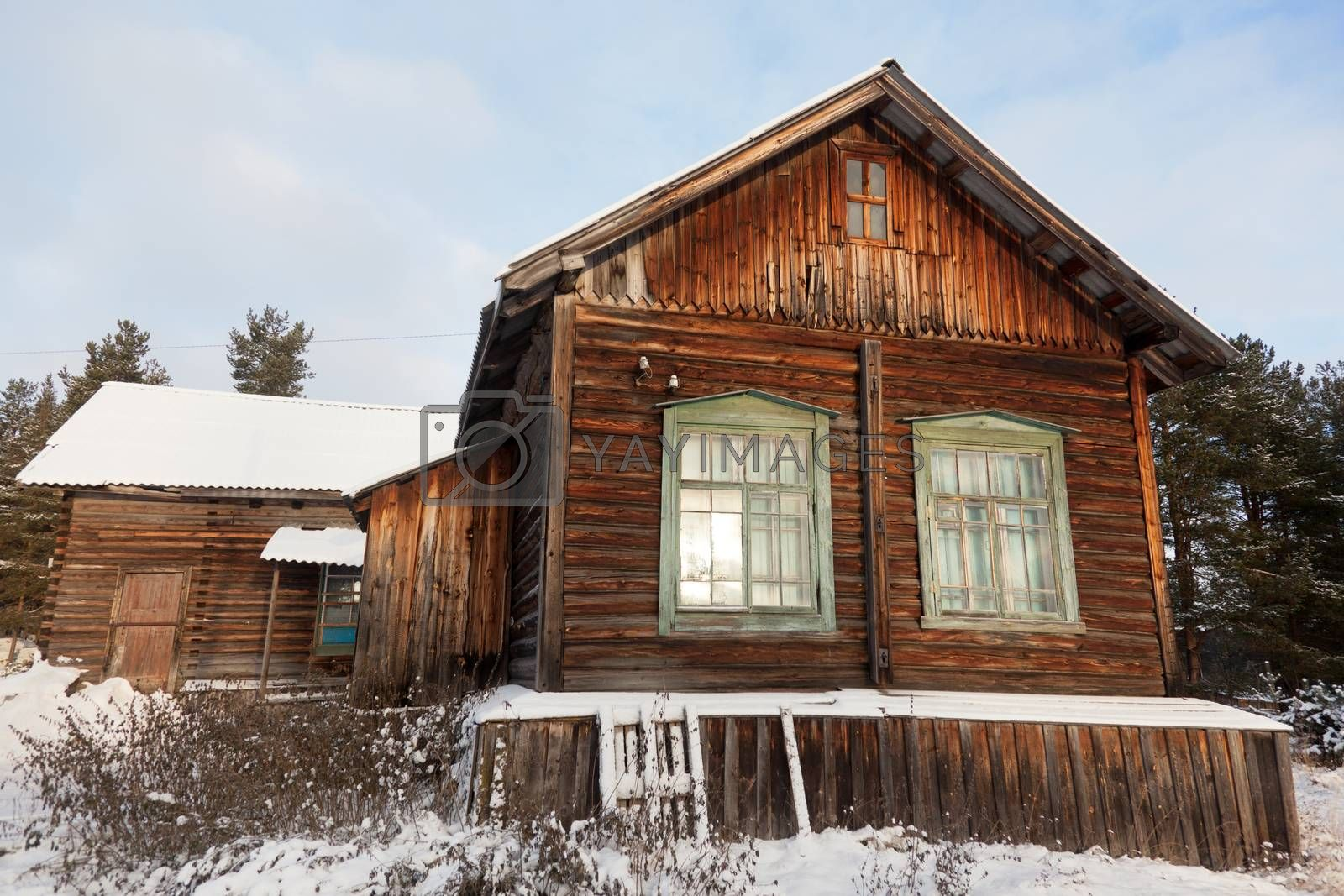 Old wooden house in the Russian village in the north