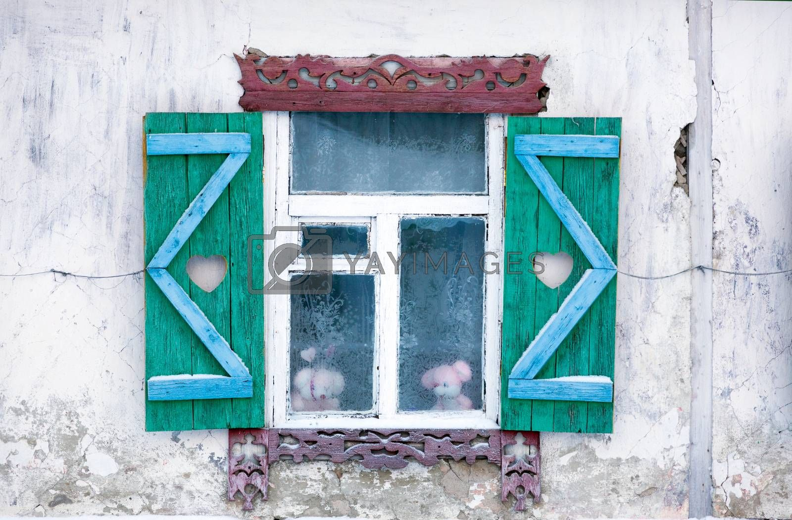 Window of the old house in the Russian village in the north