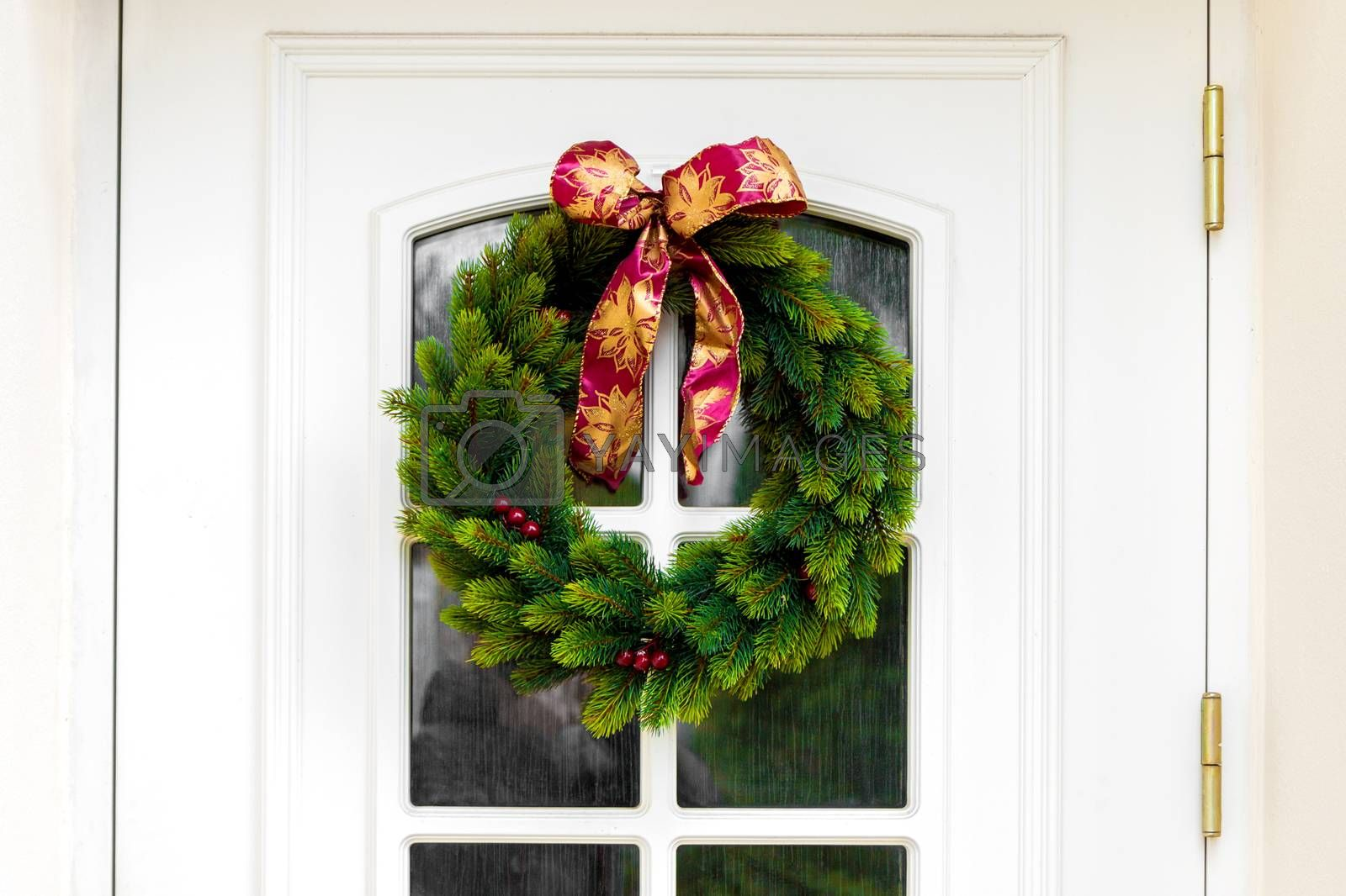 Close-up of Christmas wreath on a white home doors