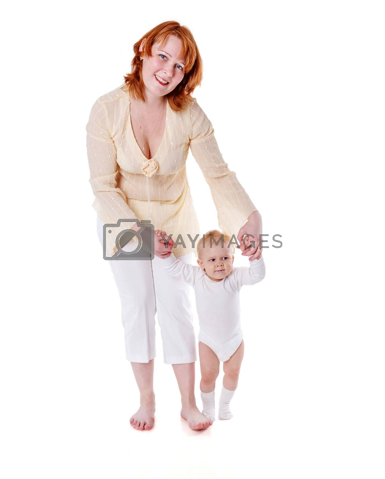 Mother holding daughter's hands first steps isolated on white