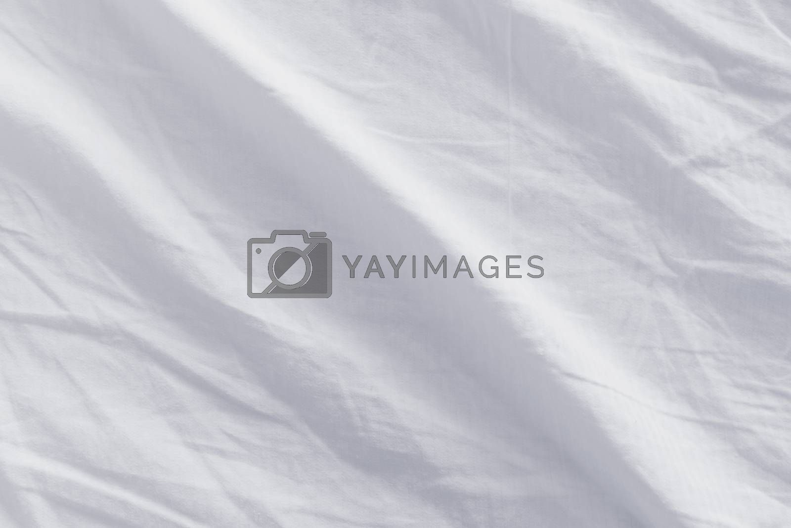 Crumpled bed sheets texture, top view of used bed sheets