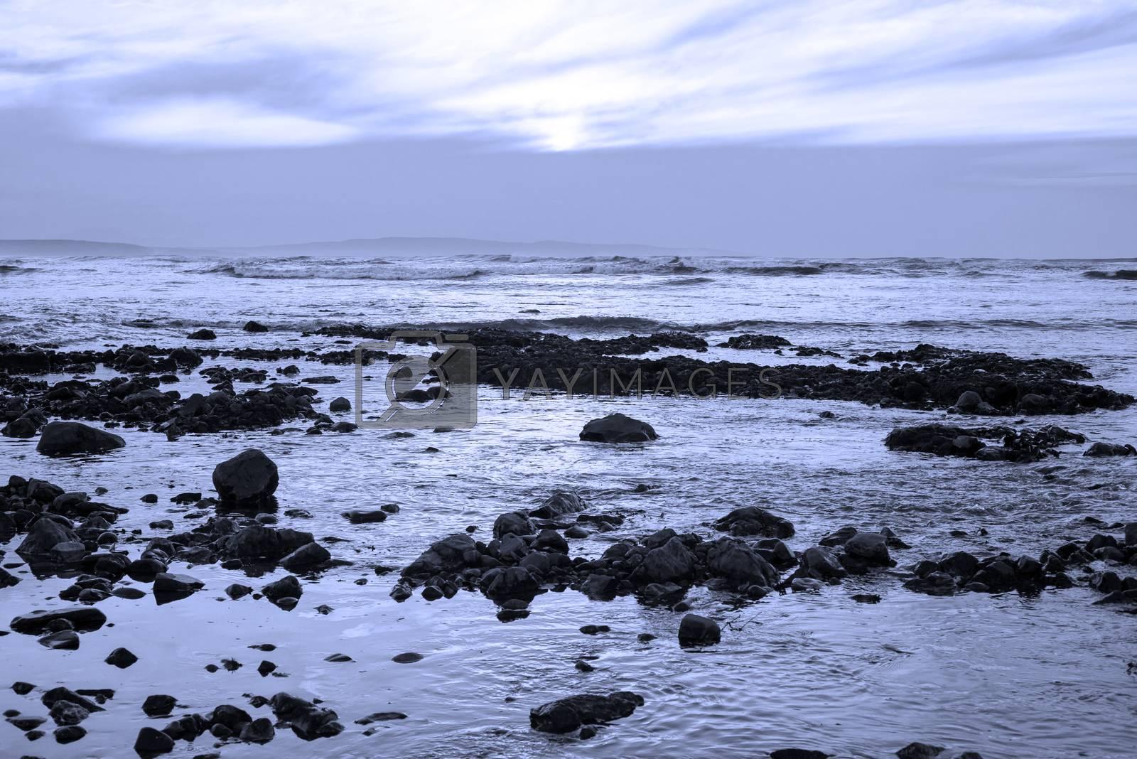 reflections at rocky beach near ballybunion on the wild atlantic way ireland with a beautiful blue tone