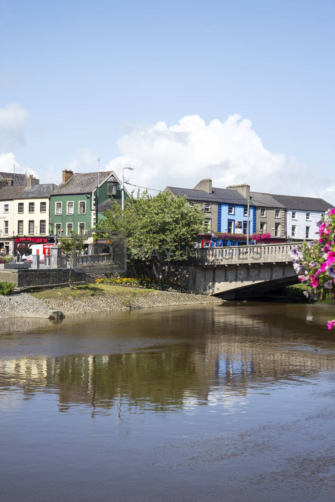 kilkenny town and bridge in reflection on the river nore in ireland