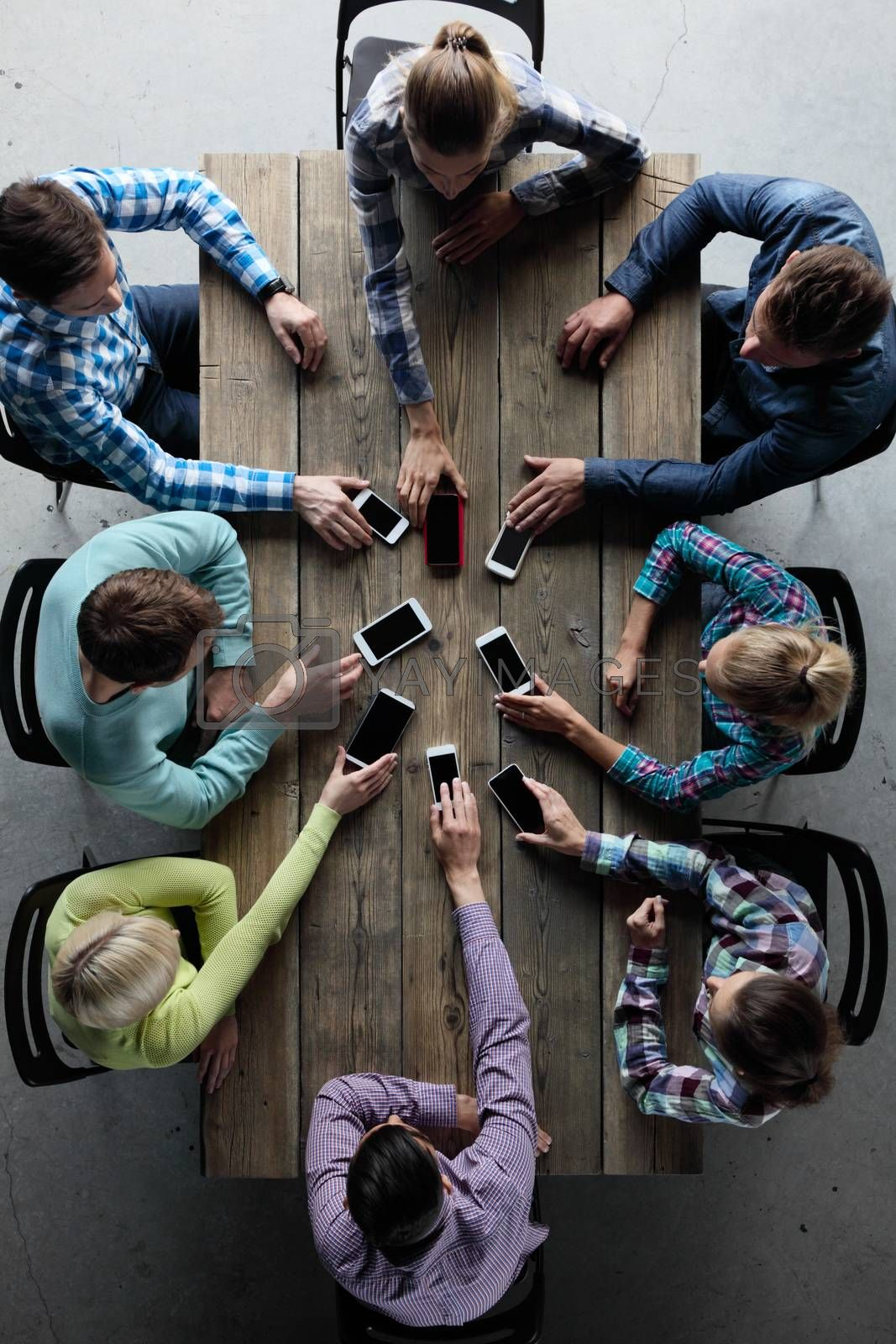 Team of people put smartphones to table, communication concept