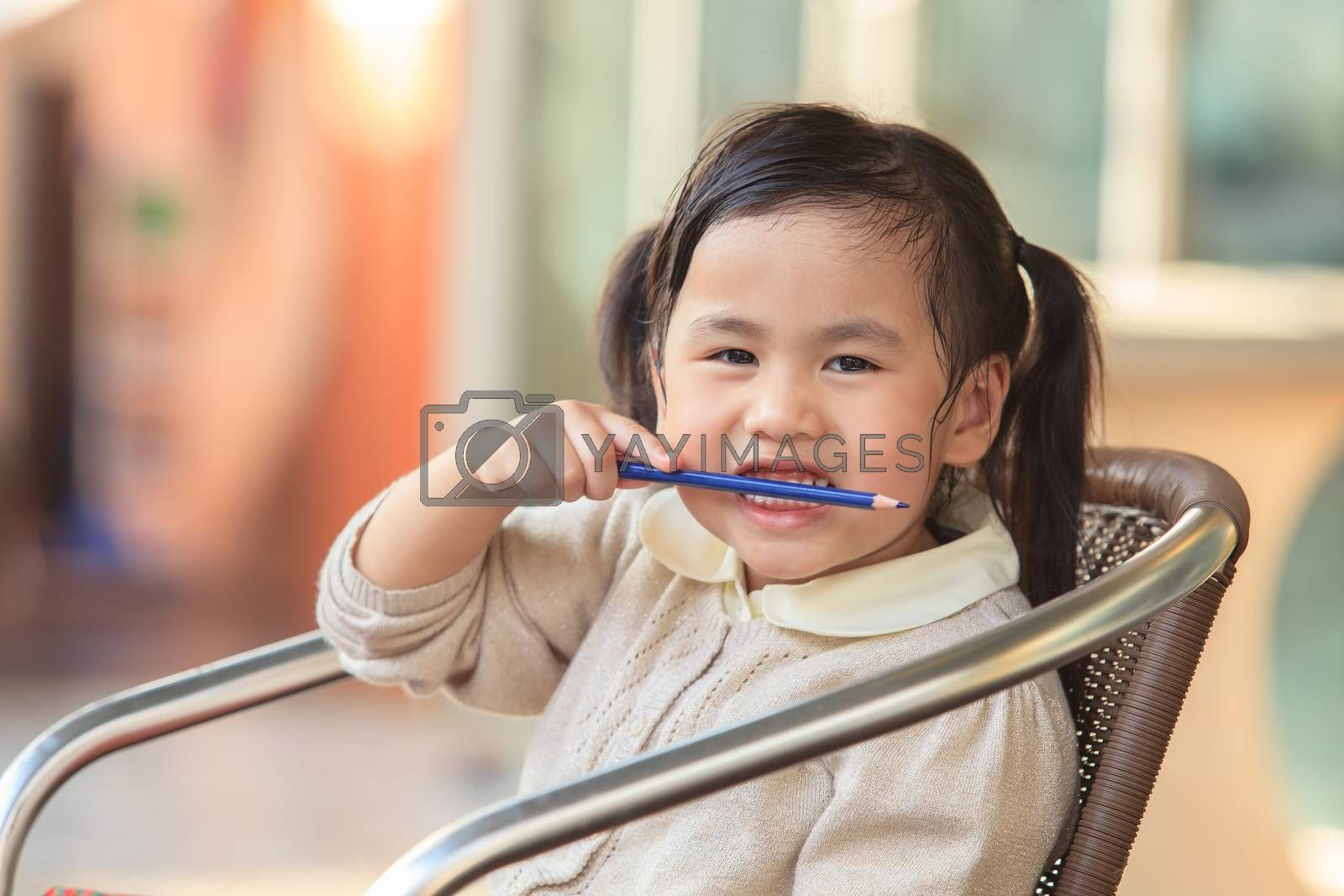 head shop photography of asian ,thai kid 4 years playing with happiness emotion at home