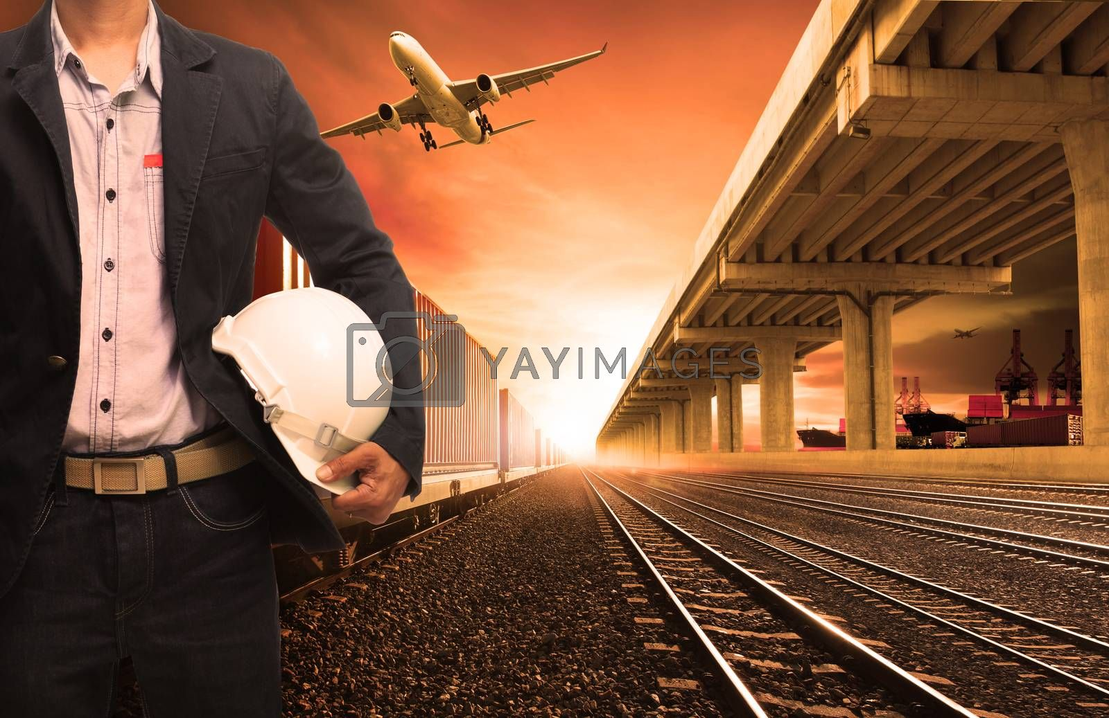 industry container trains on railways track cargo plane flying with land bridge transportation and ship port for land ,air ,ship transportation in logistic business industry ,import export,shipping