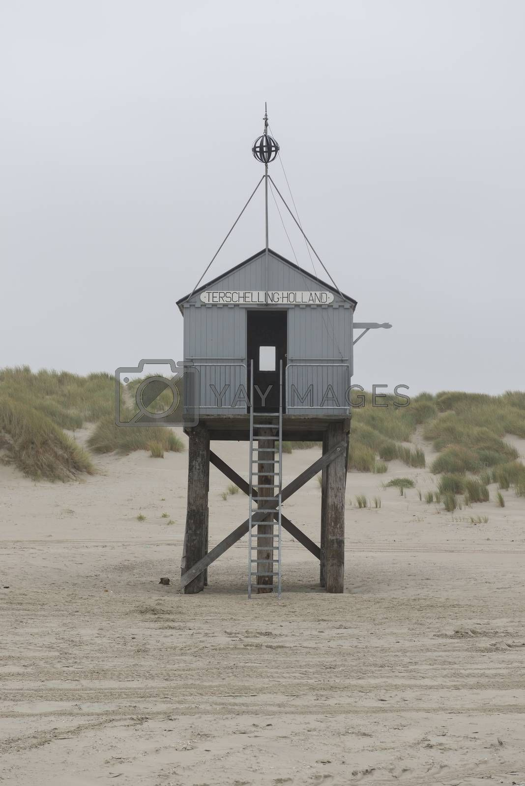 The sea cottage of Terschelling is from the end of 2015 posted near pole 24 on the North Sea Beach at the dunes on a larger and more secure distance from the North Sea on a new location. Picture was taken on a foggy and drizzly autumn day