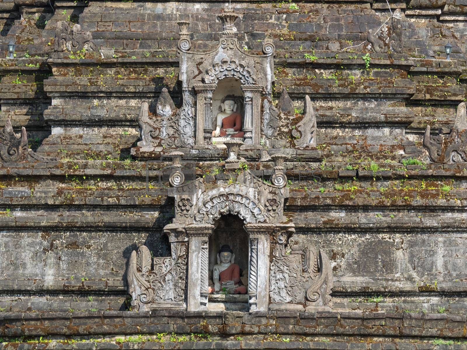 Detail of Sakya Man Aung, a pagoda in Mrauk U, the Rakhine State of Myanmar, with two small Buddha images in wall niches.