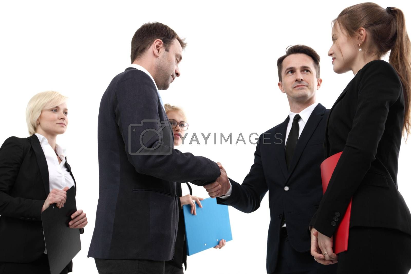 Business people shaking hands finishing up a meeting, isolated on white