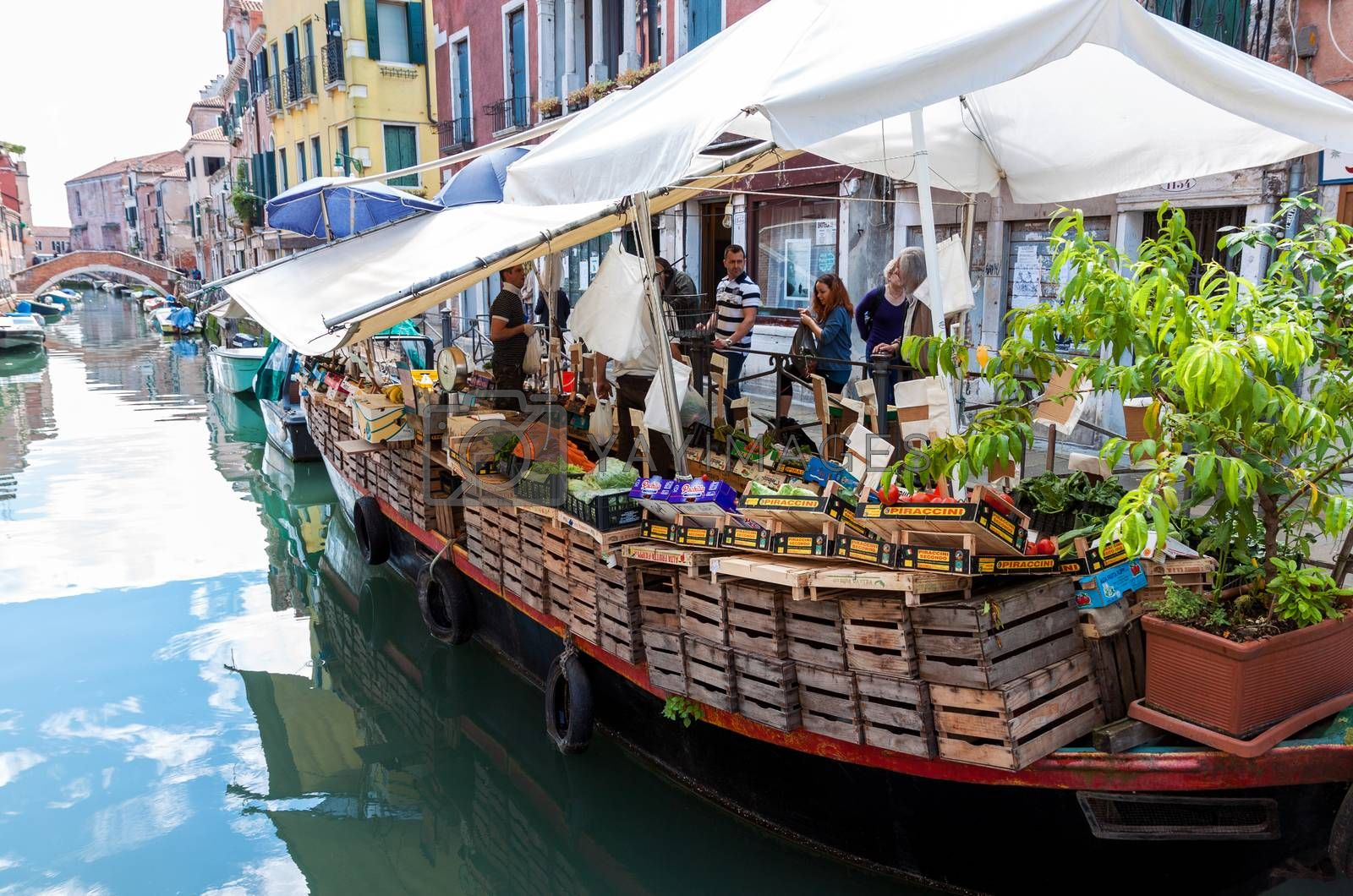 VENICE, ITALY - MAY 27, 2015: Floating market selling fruits and vegetables at Via Giuseppe Garibaldi in Venice, Italy