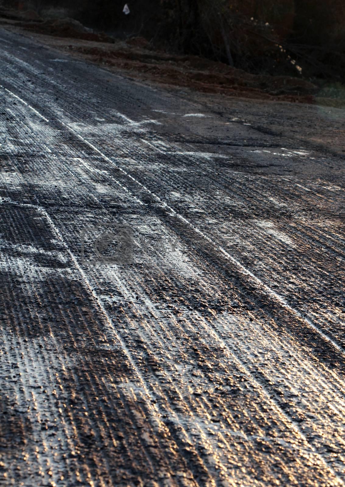 pixture of a repairing asphalt on old road on sunset