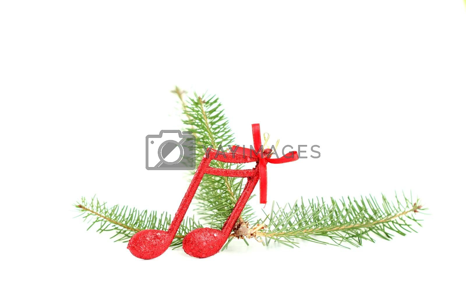 picture of a cristmas music notes decoration on a tree branch