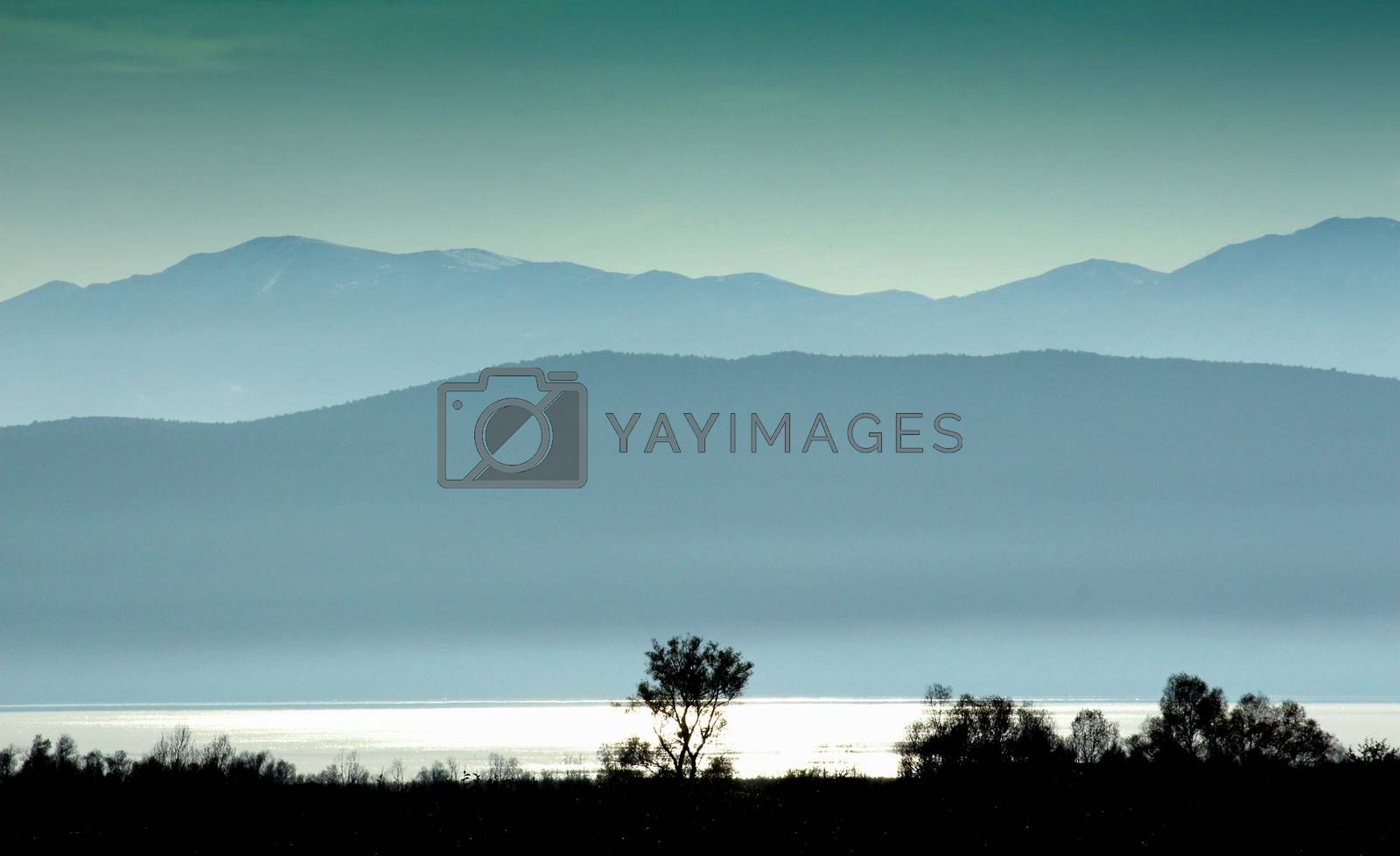 picture of a sunset on a lake prespa in macedonia