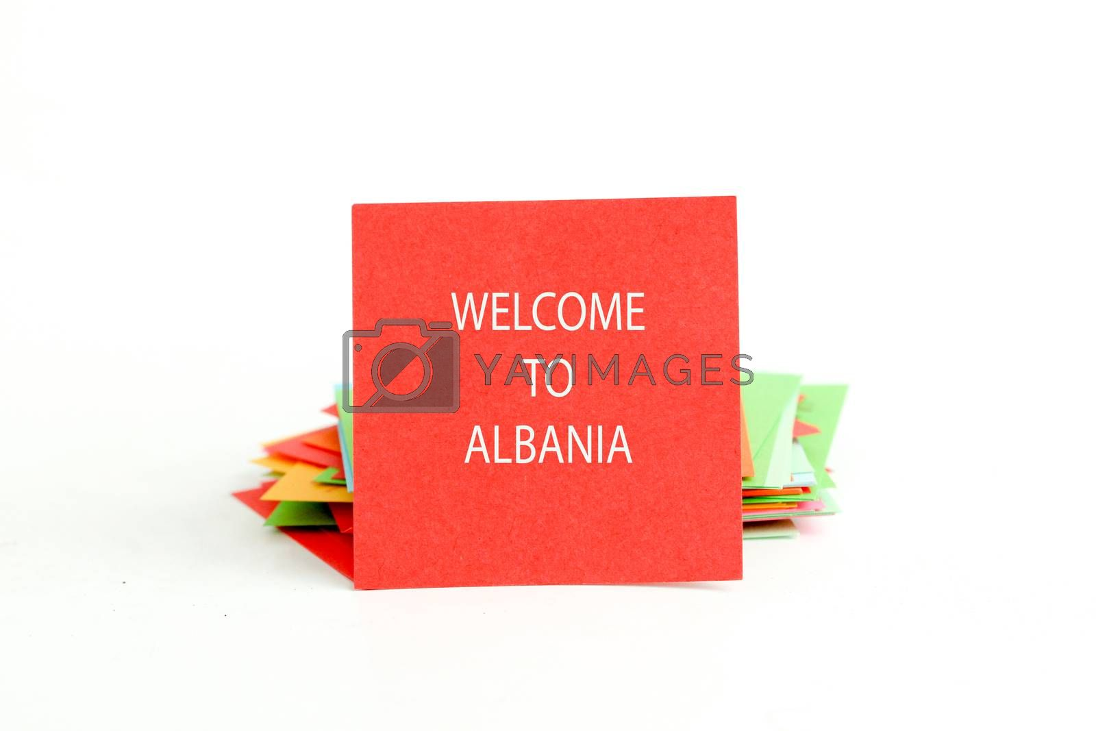 picture of a red note paper with text welcome to albania