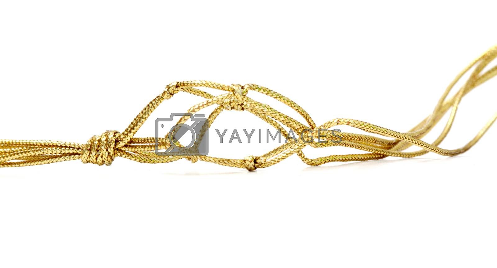 Royalty free image of gold colored rope by nehru