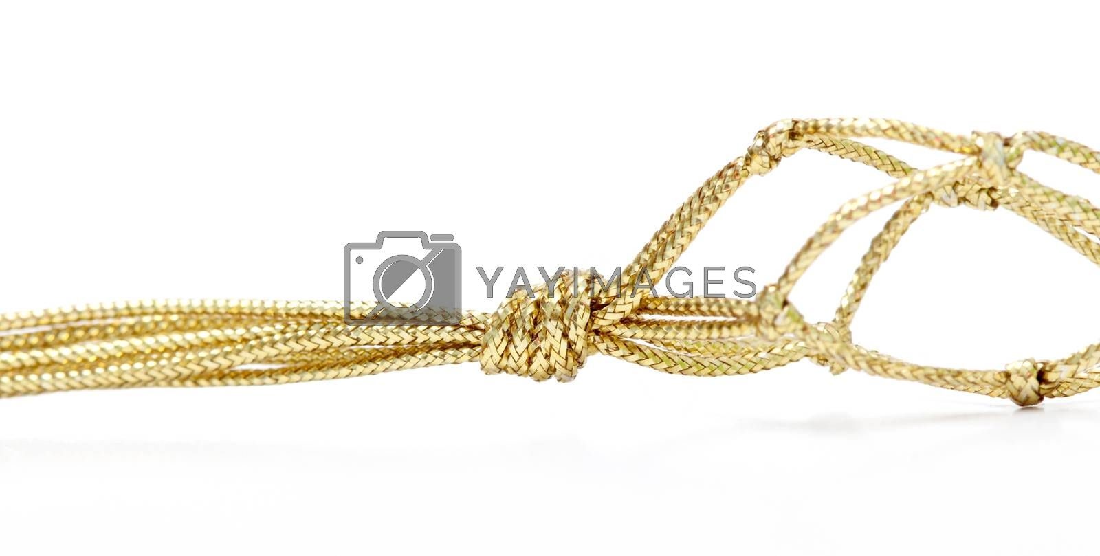gold colored rope by nehru