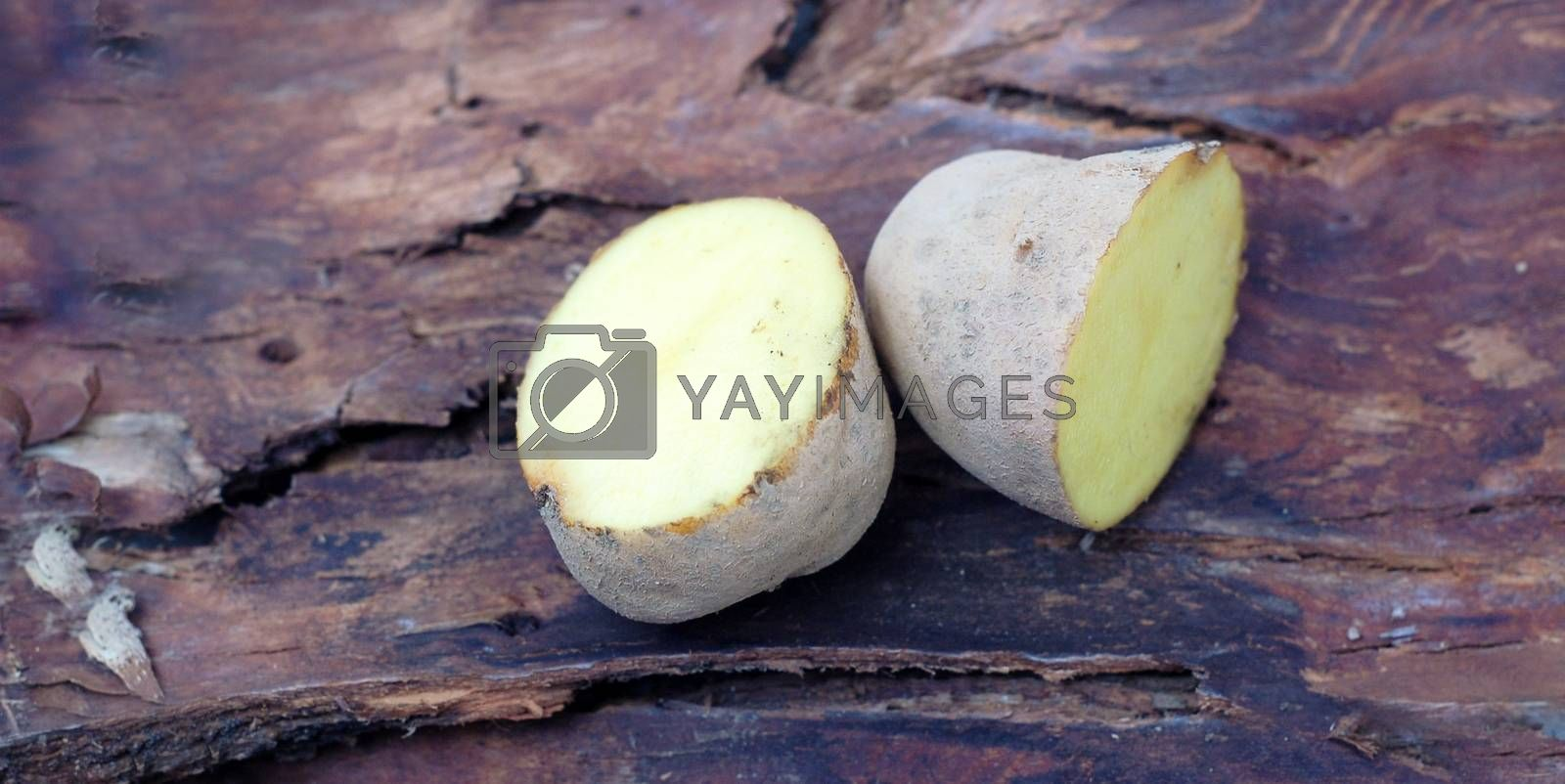 picture of a Sliced potatoes on dark wood background