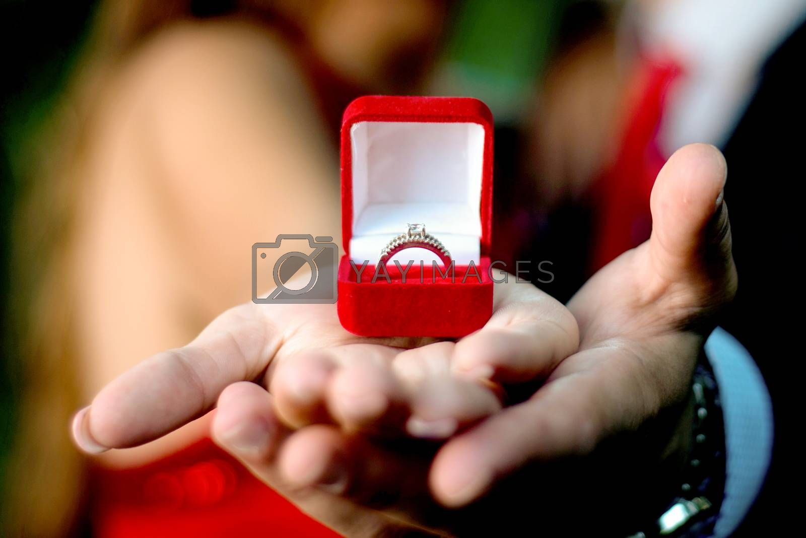 Engagement ring on womans hand held by her friend , picture of a