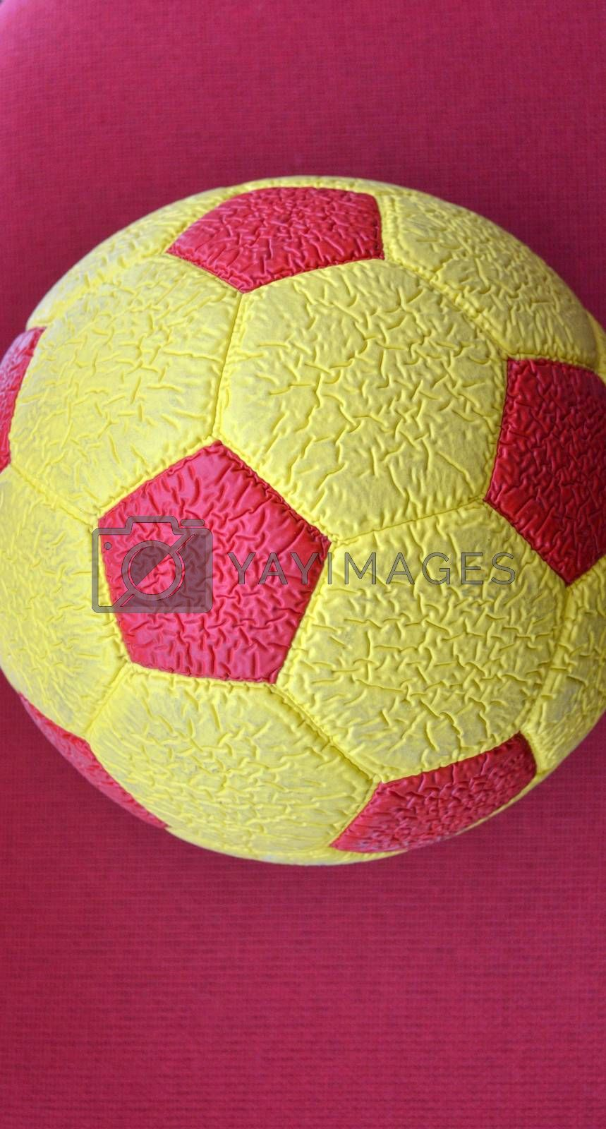 picture of a Red and yellow Soccer Ball macro, texture