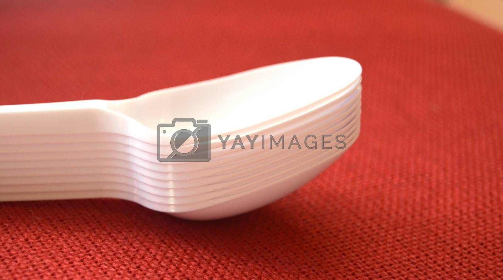 picture of a plastic disposable spoons,food concept