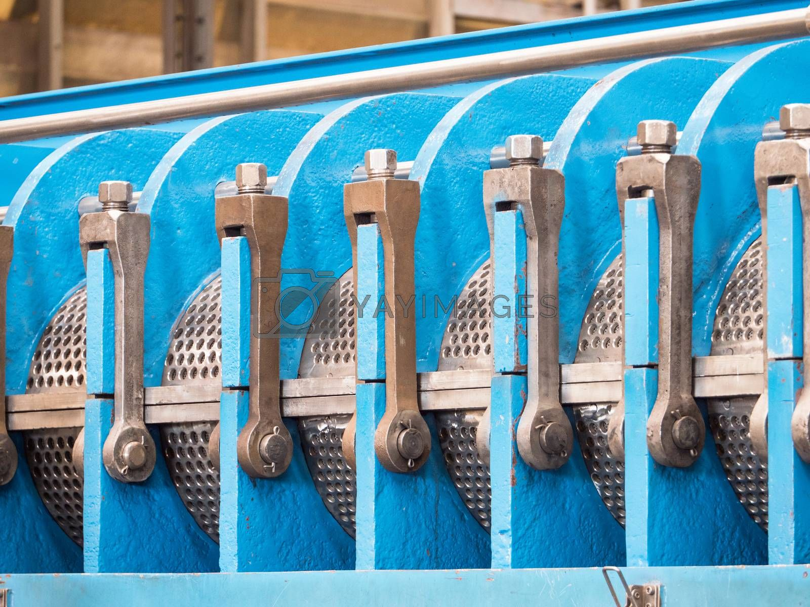 Detail photo of twin screw industrial press for processing, of food byproducts.