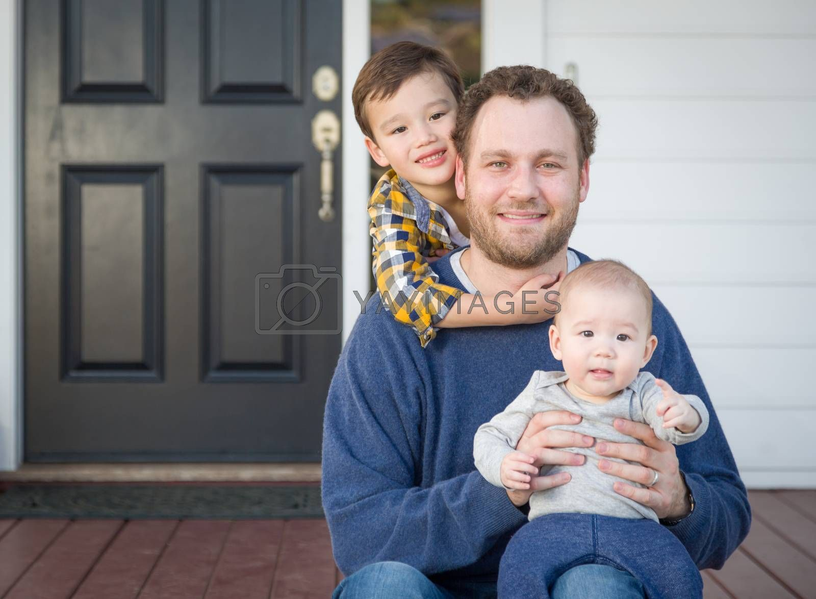 Mixed Race Father and Sons on Front Porch by Feverpitched