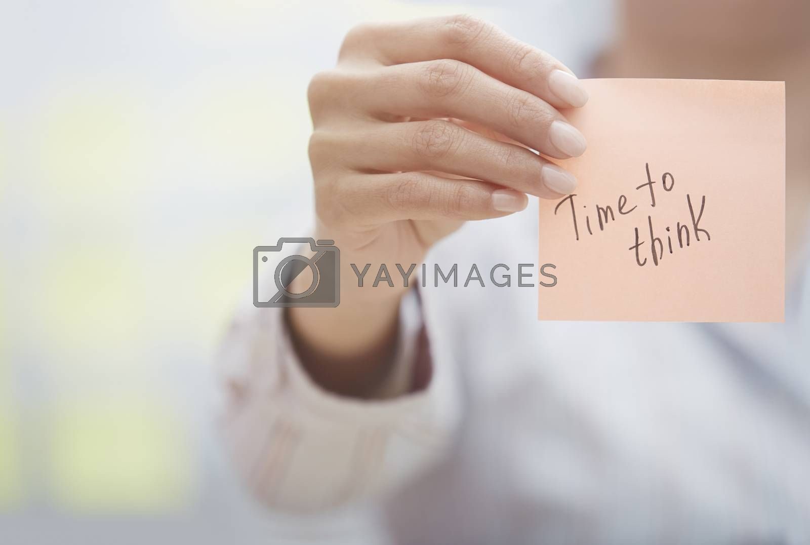 Woman holding sticky note with Time to think text