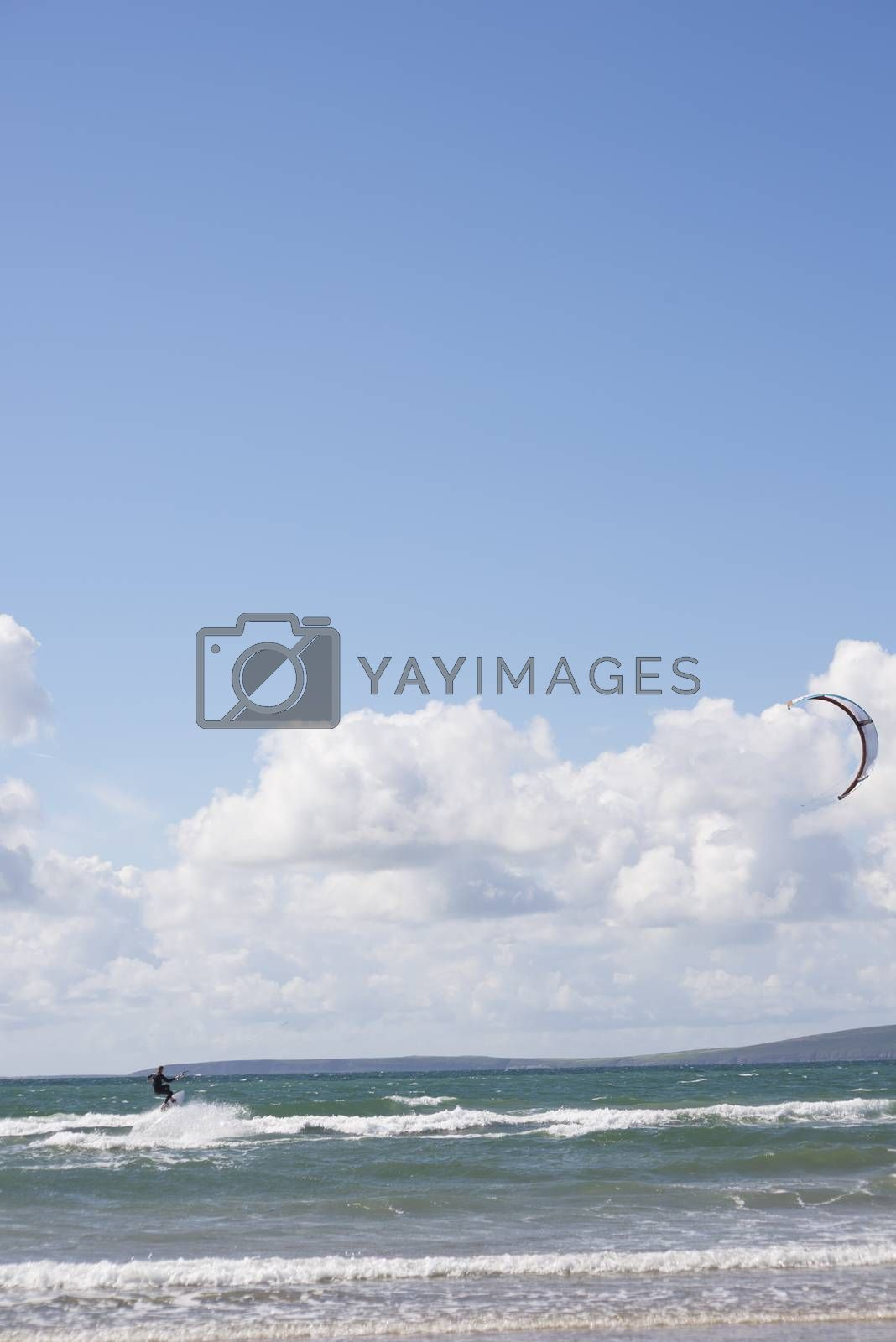 extreme kite surfer on beautiful waves at beach in ballybunion county kerry ireland on the wild atlantic way