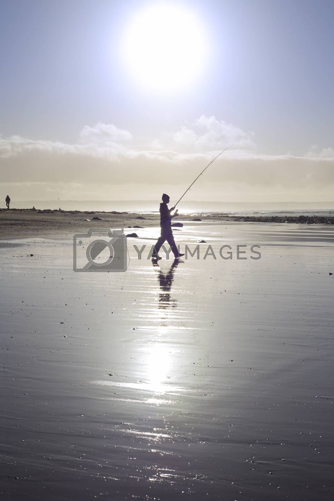lone fisherman fishing on the beach in Ballybunion county Kerry Ireland