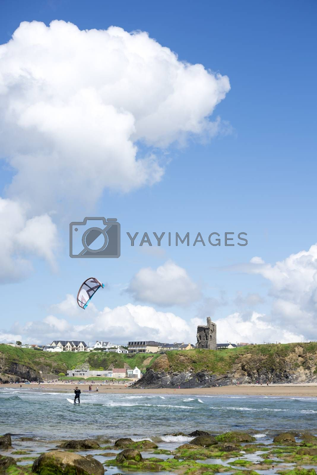 lone kite surfer riding with the waves at ballybunion beach on the wild atlantic way