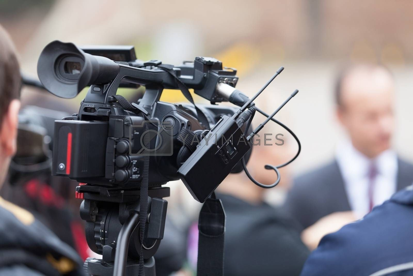 News conference. Covering an event with a television camera.