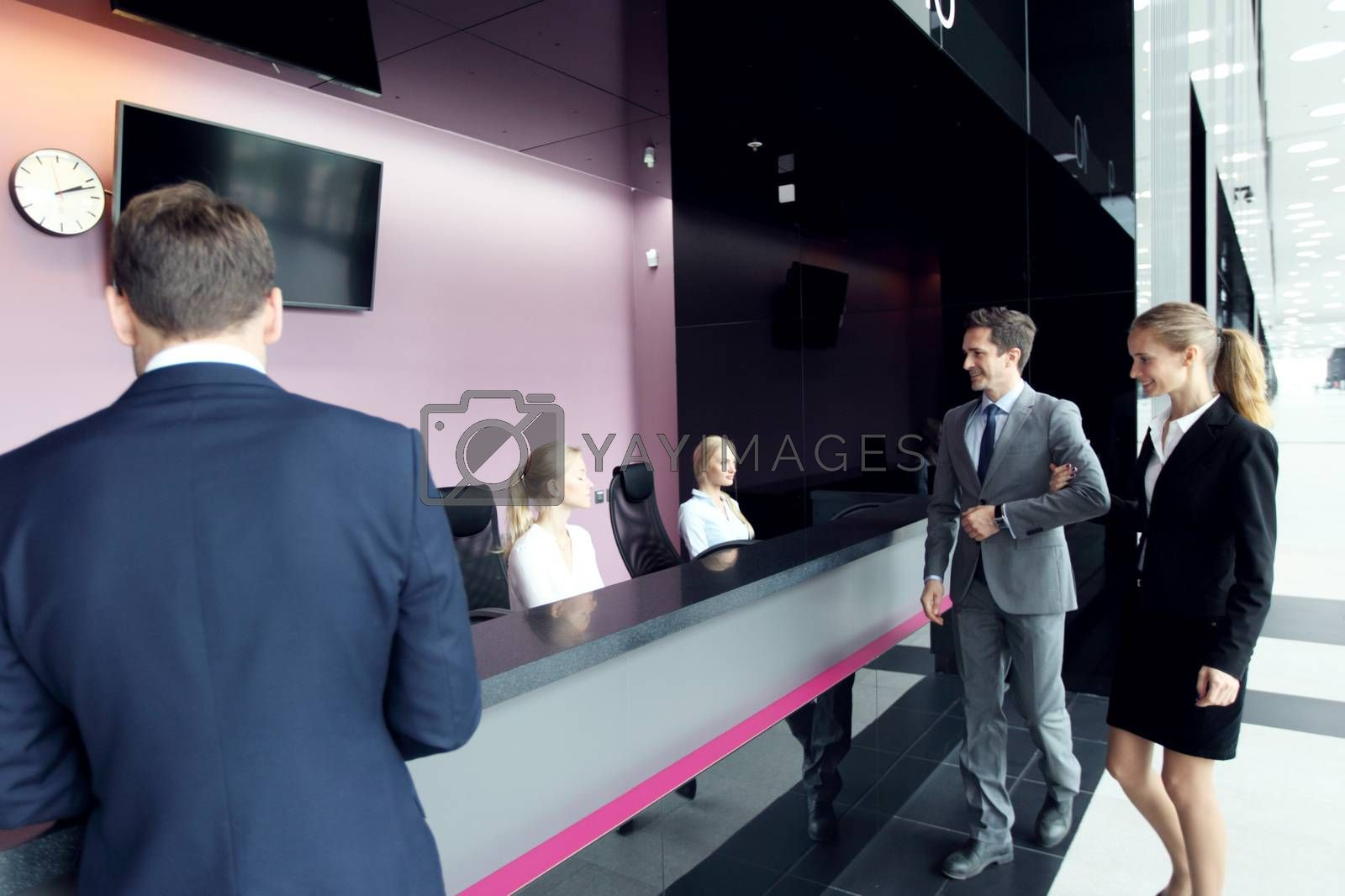 Business people at front desk of airport or modern office building