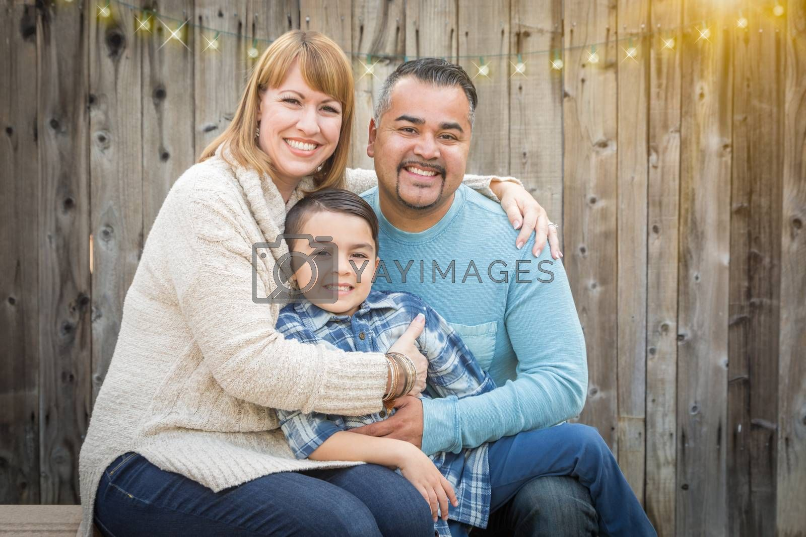 Happy Young Mixed Race Family Portrait Outside.
