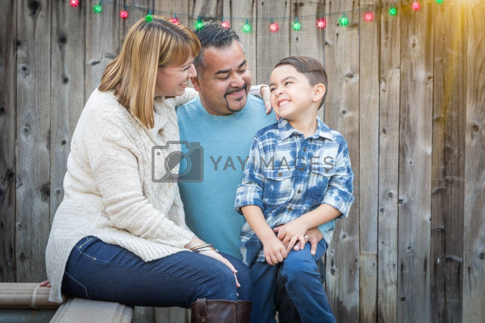 Happy Young Mixed Race Family Portrait Outside with Christmas Lights and Snow Effect.